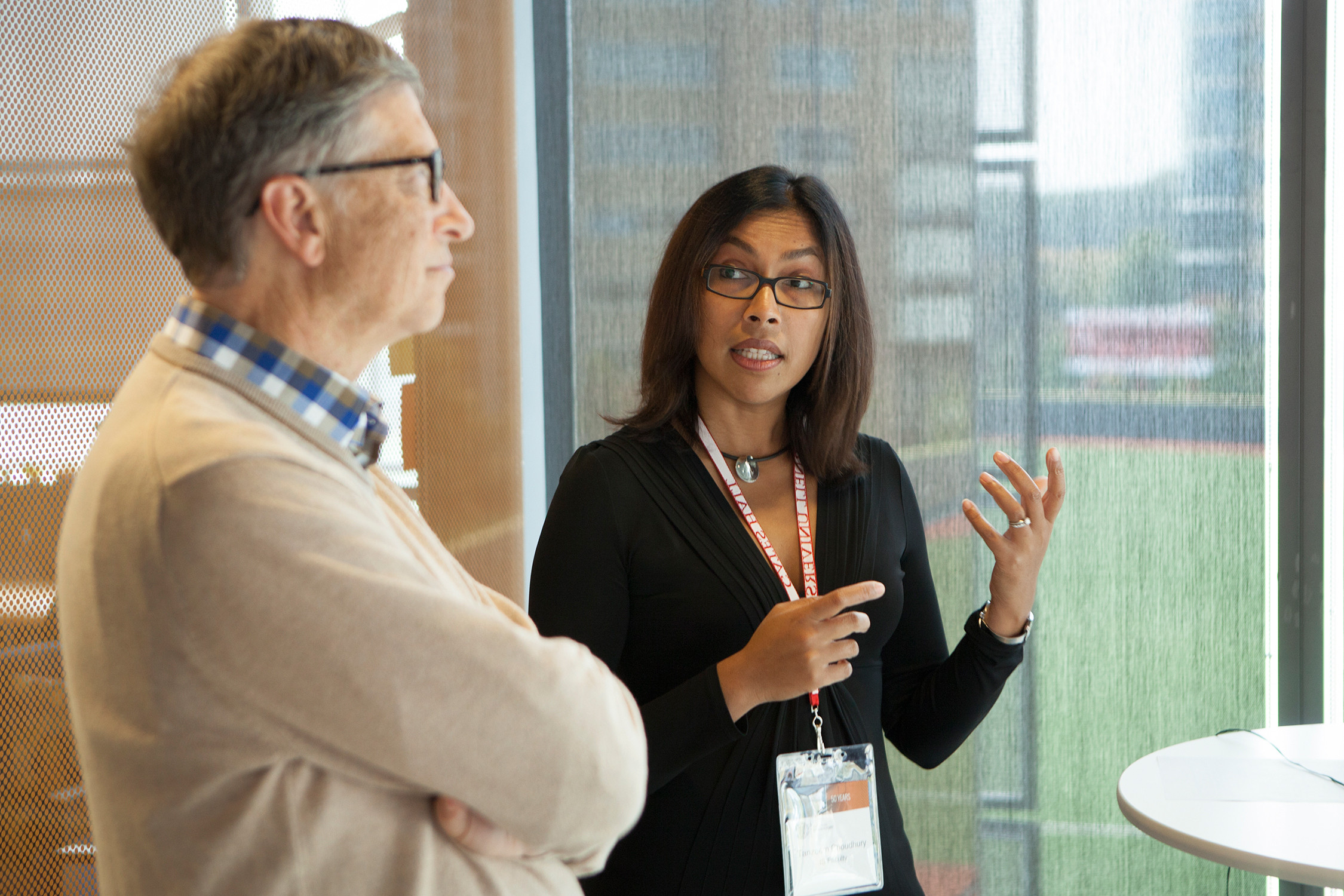 Info Sci Professor Tanzeem Choudhury talks with Bill Gates during his visit to the Cornell campus.