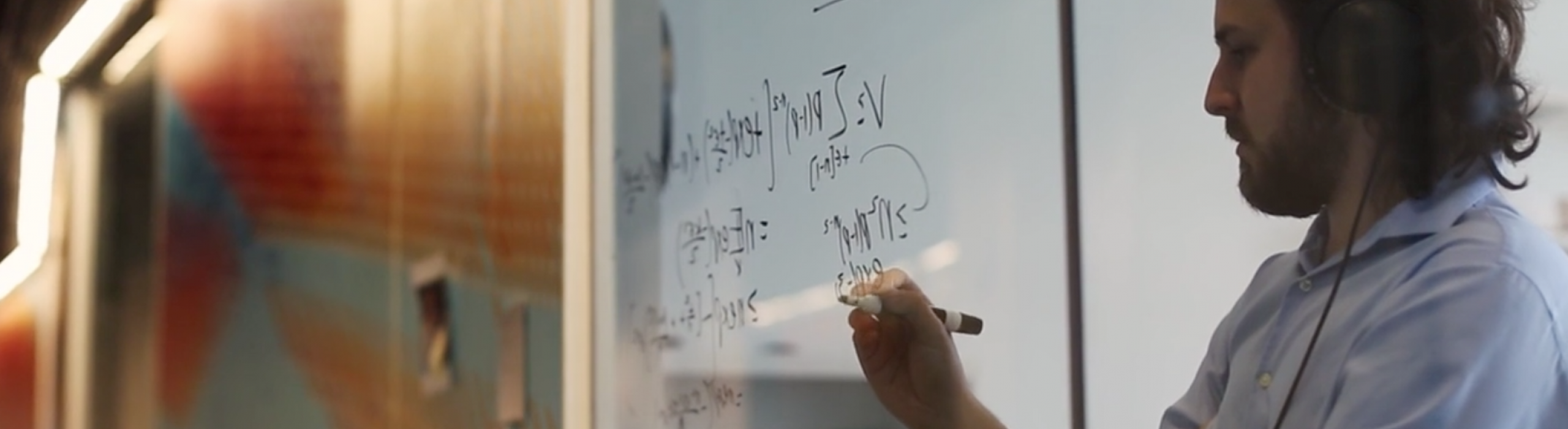 A CIS student works through a statistical problem.