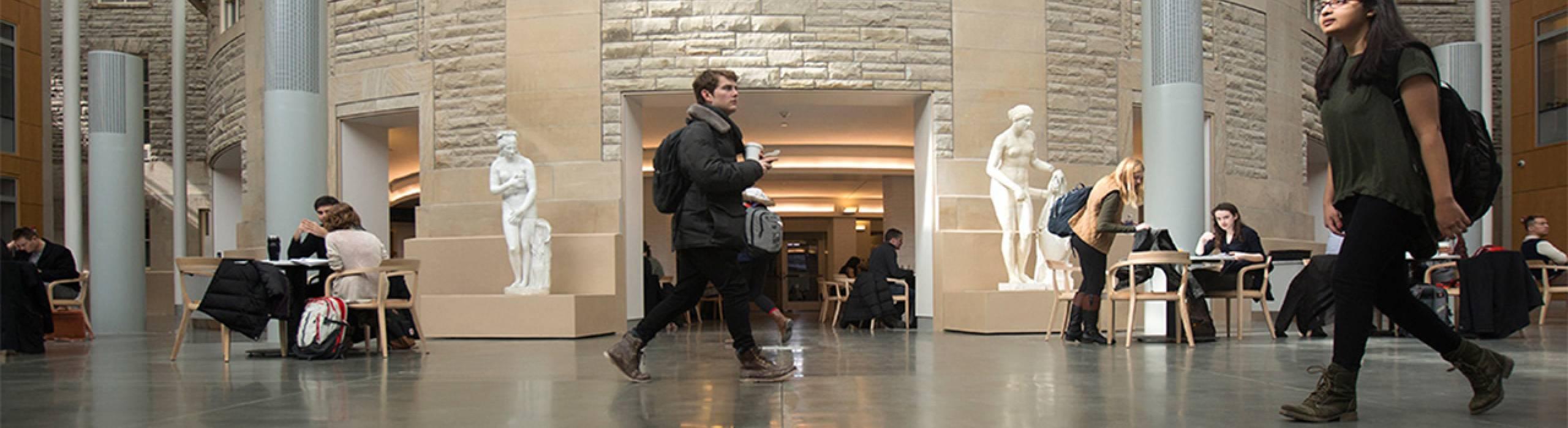 Arts and Sciences (CAS) students walk through the Klarman Hall atrium.