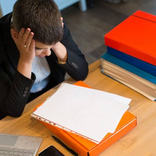 Stressed student looks over paperwork (iStock)