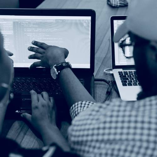 Collaborators at a computer // Photo by Lagos Techie on Unsplash