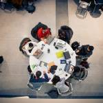 Bird's-eye view of Cornell students working around a table.