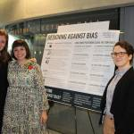 MPS students Olivia Wherry (left) and Jessie Taft (right) present their work done in coordination with Professor Karen Levy.