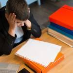 Stressed student looks over paperwork (iStock)